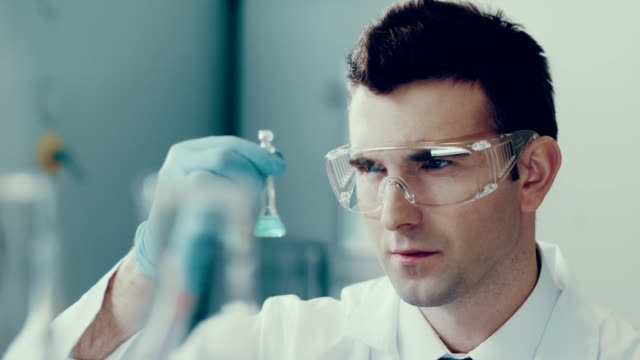 scientist in a lab. medical experiment - safety glasses stock videos & royalty-free footage