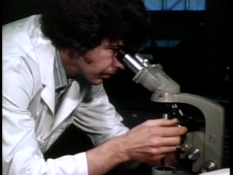 1976 MS Scientist in labaratory looking into microscope / United States / AUDIO