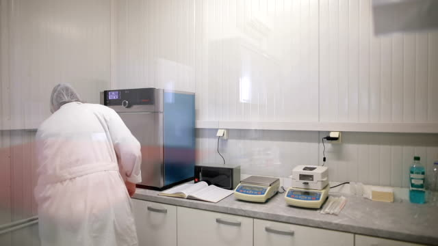Scientist in laboratory testing dairy products.Analysis of milk