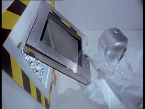 scientist in protective clothing closes autoclave door - fleischzange stock-videos und b-roll-filmmaterial