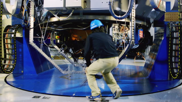 ms a scientist inspects one of the vlt telescopes at paranal observatory / chile - four objects stock videos & royalty-free footage