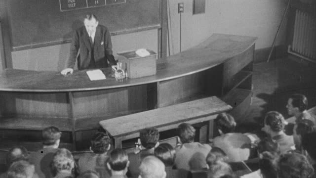 1941 montage scientist lecturing a class on the use of anti-toxins to treat and prevent diphtheria in new york city / united kingdom - diphtherie stock-videos und b-roll-filmmaterial