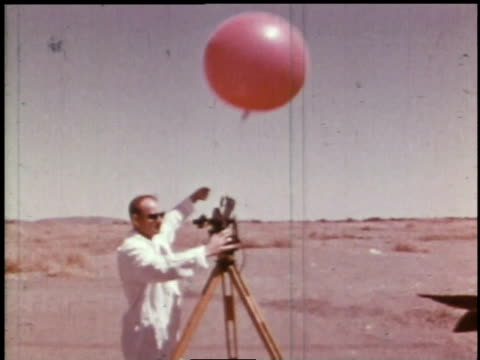 1966 ts scientist lets go of balloon for weather forecasting tests / hanford, washington, united states - weather stock videos & royalty-free footage