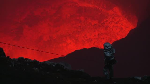 Scientist observes erupting lava lake, Marum Volcano, Ambrym Island, Vanuatu