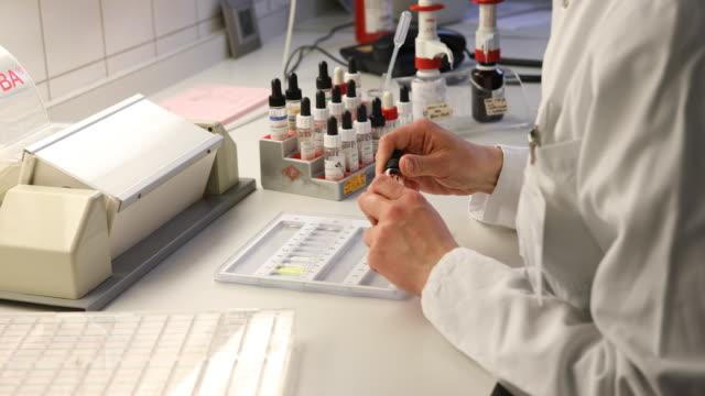 scientist preparing samples for test at hospital - sample holder stock videos & royalty-free footage