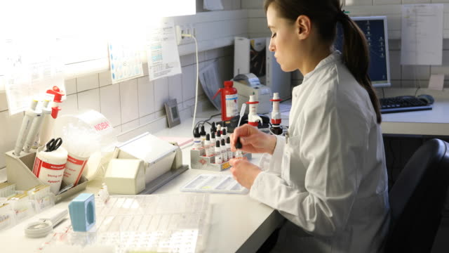 Scientist preparing samples for test at hospital