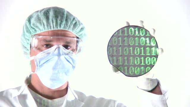 Scientist presenting Computer Chip Wafer