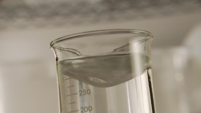 cu, scientist putting droplets of green liquid in lab flask, atlanta, georgia, usa - mixing stock videos & royalty-free footage