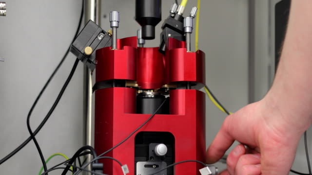Scientist Putting Samples in Tunable Wavelength Pulsed Laser