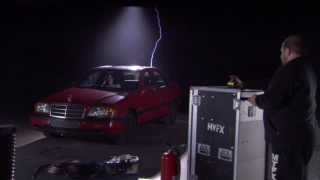 a scientist runs lightning tests on an automobile. - tesla coil stock videos and b-roll footage