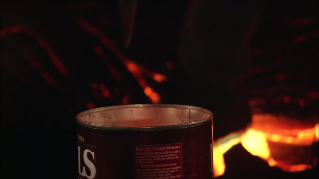 a scientist scoops lava into a can. - geology stock videos & royalty-free footage