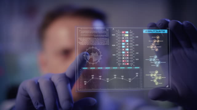 vídeos de stock e filmes b-roll de scientist studying dna mutations. holding virtual touch screen - mutação genética