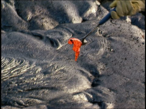 TU scientist taking lava sample, MS