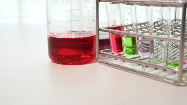Scientist test solutions in laboratory
