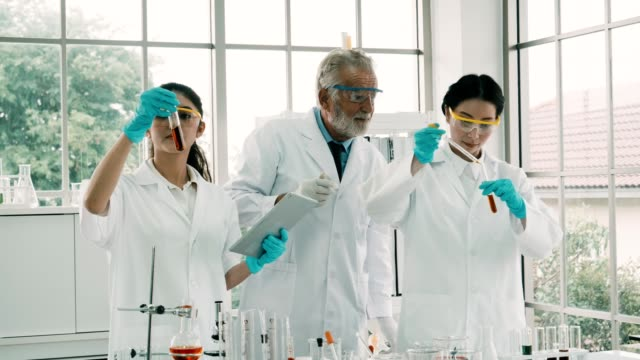 scientist using a pipette in laboratory - safety glasses stock videos & royalty-free footage
