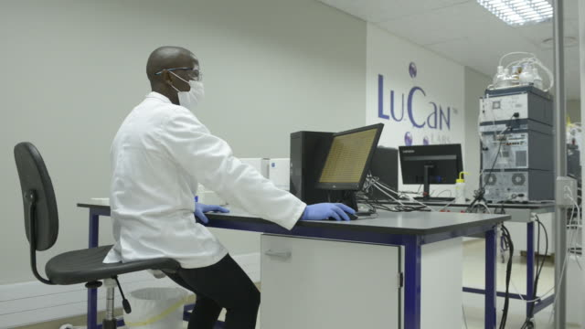 scientist using computer at lucan labs lesotho during research on medical cannabis, maseru, lesotho, on thursday, november 14, 2019. - computer monitor stock videos & royalty-free footage