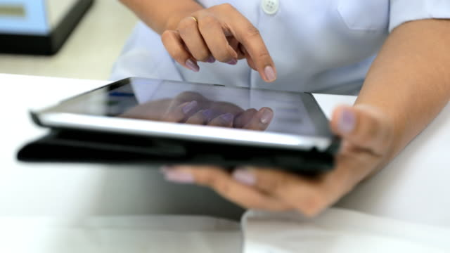 scientist using digital tablet in laboratory - receiving stock videos and b-roll footage