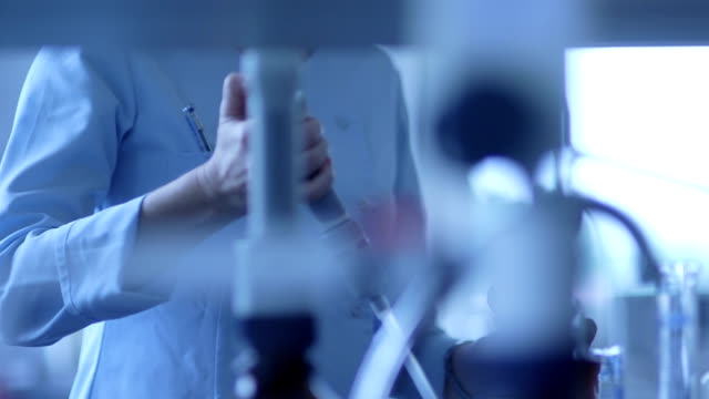 Scientist using pipette while performing experiment