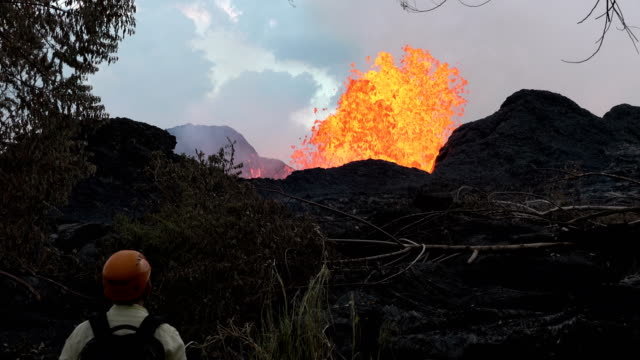 scientist watch incredible lava fountains erupting from fissure at kilauea volcano in hawaii in may 2018 - big island hawaii islands stock videos & royalty-free footage
