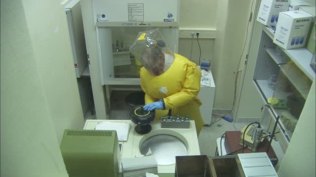 ha ms zi cu scientist wearing protective suit using laboratory equipment / hamburg, germany - giftstoff stock-videos und b-roll-filmmaterial