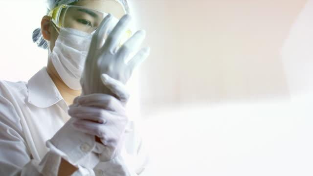 Scientist woman wearing glove