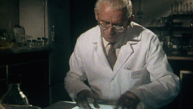 montage scientist working at desk with pen, paper, maps, and ruler, calculating the effect of nuclear fallout on survivors during a hypothetical nuclear conflict / united kingdom - nuclear fallout stock videos and b-roll footage
