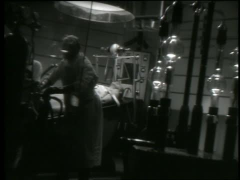 B/W scientist (Edmund Gwenn) working in laboratory