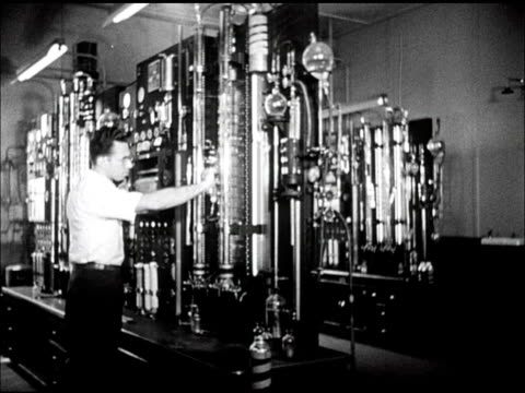 Scientist working w/ equipment MS Seismograph machine seismogram paper roll [VO Saying gasoline can now be made from natural gas]