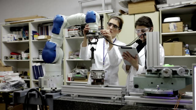 Scientist working with robotic arm