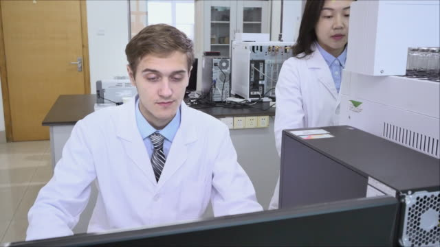 scientist works in modern biological lab - scientific treatise stock videos and b-roll footage