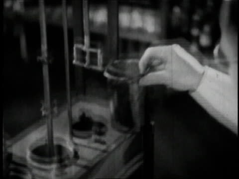 1936 b/w scientists and brewers testing beer at anheuser busch brewery in st. louis / missouri, united states  - anheuser busch inbev stock videos and b-roll footage
