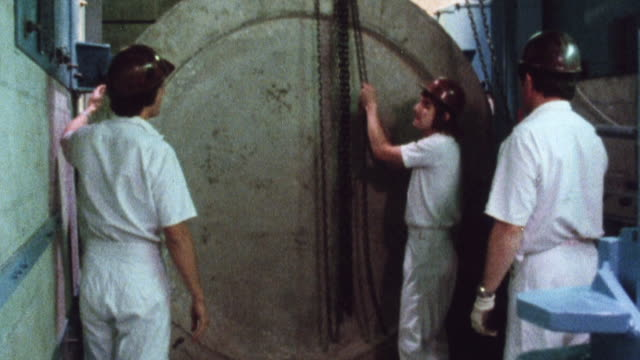 stockvideo's en b-roll-footage met 1981 montage scientists and engineers conducting small scale missile testing to measure the strength of concrete construction used for nuclear power plants / united kingdom - raket wapen