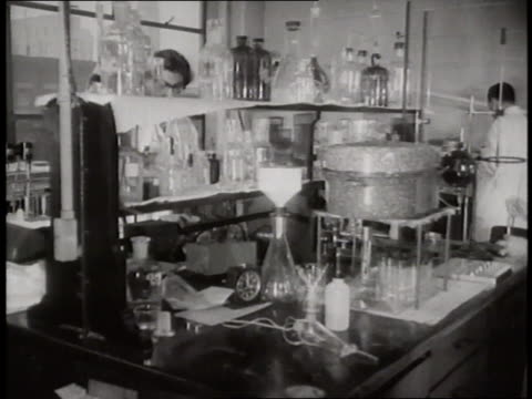 scientists conduct experiments in a laboratory - becher video stock e b–roll