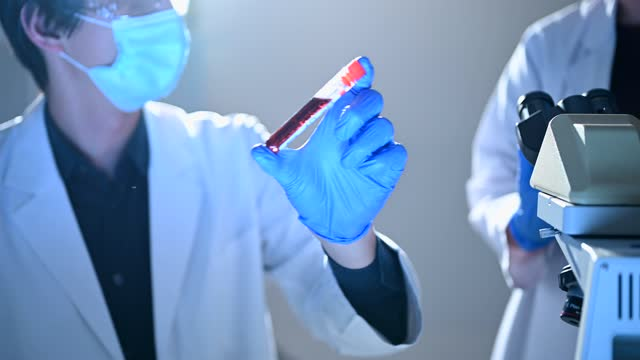 scientists discussing while looking at a blood sample. - chemistry stock videos & royalty-free footage