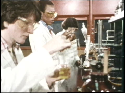 scientists do experiments in a laboratory - becher video stock e b–roll