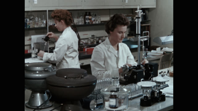 scientists doing research in chemical laboratory - clip stock videos & royalty-free footage