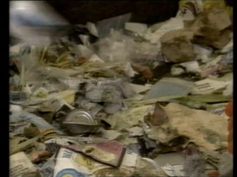 stockvideo's en b-roll-footage met scientists examining garbage studying what people throw away in order to figure out how to cut down on waste in the future / man sweeping up landfill... - afvalverwerking