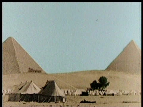 scientists exit toomb / camels cross desert / the great pyramid - pharaoh stock videos & royalty-free footage