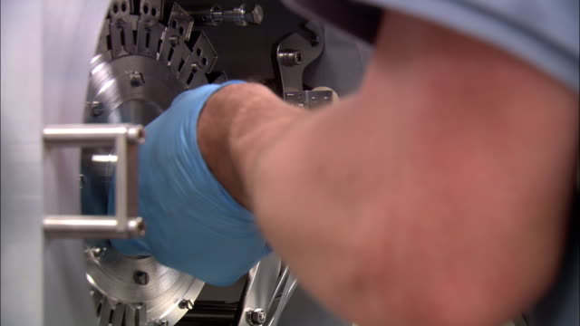 a scientist's gloved hands open a chamber and insert a device. - inserting stock videos & royalty-free footage