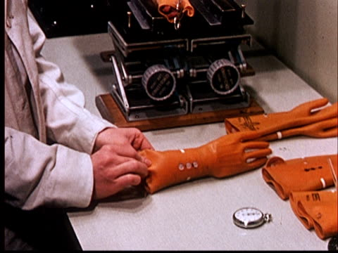 1960 MS Scientist's hands inserting guinea pig into rubber glove/ Two guinea pigs in gloves being irradiated/ AUDIO