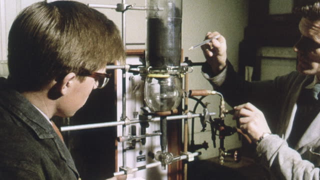 1963 montage scientists heating fluidized coal and drawing it into a glass container / united kingdom - formula stock videos & royalty-free footage