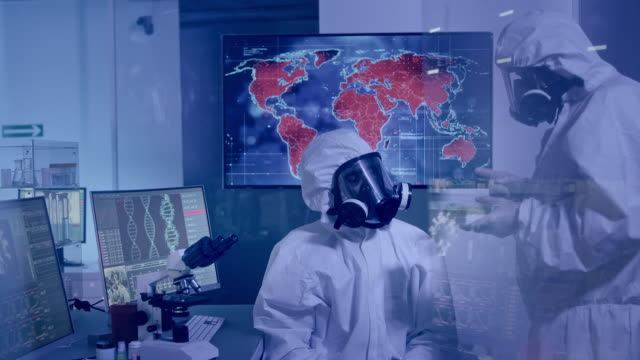 scientists in clean suits discussing during research. infected world - illustrazione biomedica video stock e b–roll
