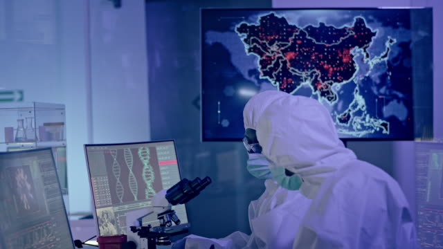 scientists in futuristic laboratory working with biohazardous substance. first infections on asia map - illustrazione biomedica video stock e b–roll