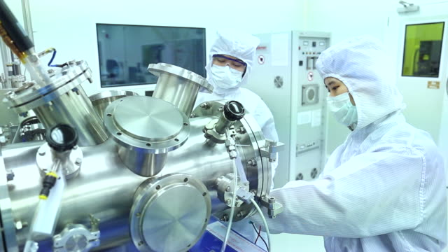 scientists in modern laboratory - clean room stock videos and b-roll footage