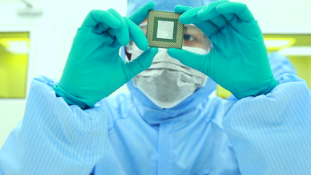 scientists in modern make computer chips - nanotecnologia video stock e b–roll