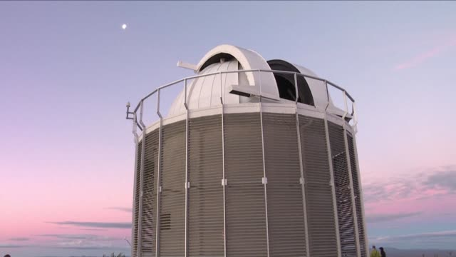 stockvideo's en b-roll-footage met scientists in south africa launch the world's first optical telescope linked to a radio telescope combining eyes and ears to try to unravel the... - clean