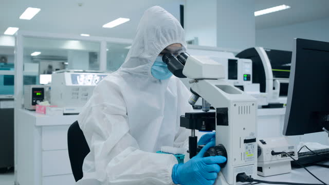 scientists in the sterile room reducing, try microscopy. to check for infection looking at platelets experimental blood sample with a microscope. - biotechnology stock videos & royalty-free footage