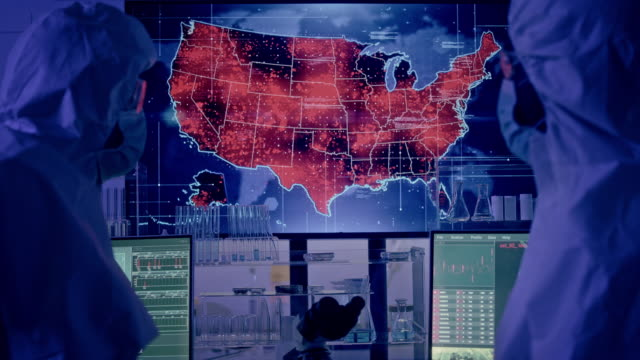 vídeos de stock e filmes b-roll de scientists looking at screen with usa outbreaks. futuristic research laboratory - mutação genética