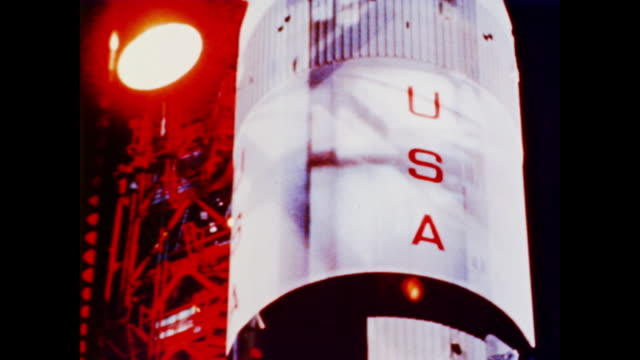 scientists mill about a space shuttle on a launchpad as the narrator explains how man made spaceflight became a reality in the 1960s - 1960 1969 stock-videos und b-roll-filmmaterial