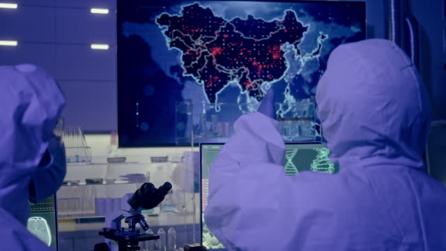 scientists monitoring first infections on map of asia. pandemic - illustrazione biomedica video stock e b–roll